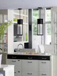 create kitchen accent using hanging pendant lamp over island at
