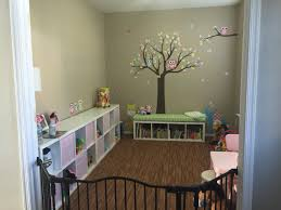 first floor home office turned into a playroom shelves and table
