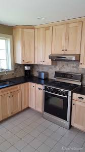 light wood kitchen cabinets with black countertops small shaker kitchen with stained cabinets and black