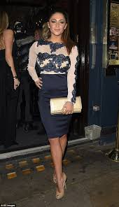 casey batchelor looks leggy in a navy lace dress for a night out