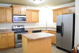 what color countertops go with wood cabinets wall colors for honey oak cabinets remodeled