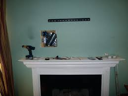 fireplace entrancing hang tv over fireplace for living ideas how