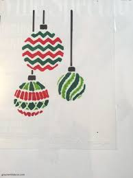 green with decor a christmas craft with a stencil and an old frame