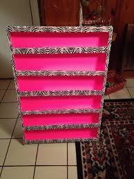 diy nail polish rack made from neon pink foam board zebra duct