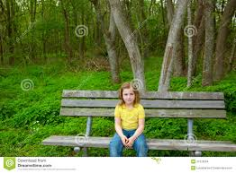 lonely children happy sitting on park bench stock images
