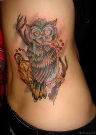 tattoo girl owl 47 mind blowing owl tattoos on rib