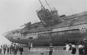 german u boats wash up on the shore of an english beach after