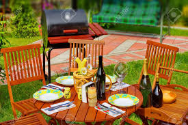 outdoor dining or picnic scene in backyard bbq grill stock photo
