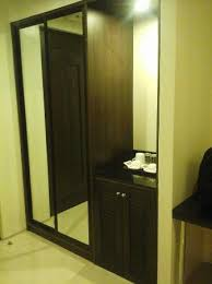 built in cabinet with a sliding door mirror picture of infinity