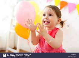 happy baby on birthday party at home stock photo royalty