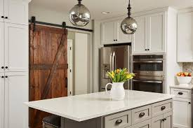 barn door for kitchen cabinets rustic barn door on rails to kitchen transitional kitchen