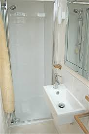 small bathroom with shower and large white tile ceramic plus half small bathroom with shower