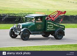 Old Ford Truck Motors - vintage ford breakdown tow truck on the goodwood motor racing