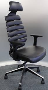 spine chair w a high cushioned back and flexible lumbar support