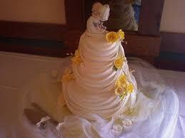 wedding flowers valley wedding cake draped yellow flowers tamara s cakes fox valley