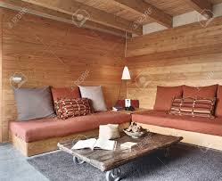 interior view rustic living room with paneling and stone