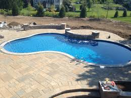 Backyard Swimming Pool Designs by Large Pool With Sheer Waterfalls Modern Design Of Backyard