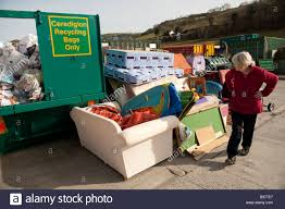 a woman looking at recycled furniture and domestic items goods at