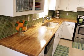 clear laminated teak wood butcher block top above whie polished