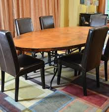 arhaus copper arabesque dining table and eight leather chairs ebth