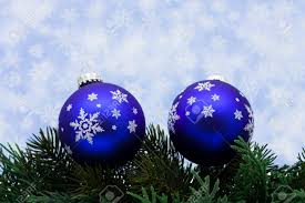 tree limb with blue glass ornaments on snowflake