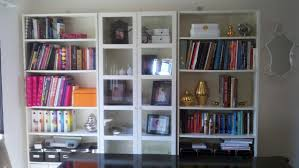 Bookcase With Door by Furniture Exciting Ikea Billy Bookcase With Beige Armchairs And