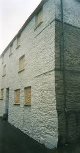 painting the exterior of a stone building in totnes 2002 never