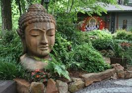 per your mind with buddha figures in the garden fresh design