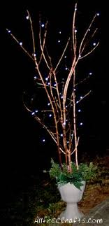 christmas branches with lights painted branches with christmas lights there s no place like home