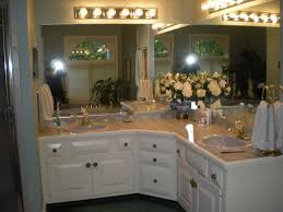 bahtroom fresh flower decor closed big mirror under wall lamp on