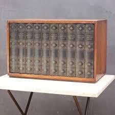 1950s prohibition style hidden revolving liquor cabinet library