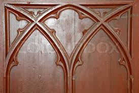 brown wooden door ornament of an ancient church stock photo