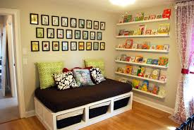 4 compartement white stained wooden wall bookshelves on peach