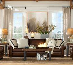 Living Room Decor With Brown Leather Sofa The Vase And Lanterns The Interior Design