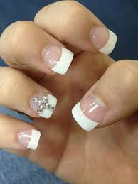 nail designs with rhinestones and crosses cross acrylic nails