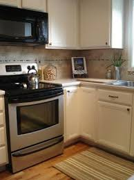 Wooden Kitchen Cabinet by Best 25 Repainted Kitchen Cabinets Ideas On Pinterest Painting