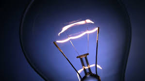 close up of the filament of an electric light bulb glowing on and