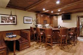 small basement ideas decor ceiling beams and bar cabinet with bar stools also dining