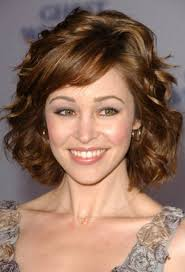 hair styles for layered thick hair over 40 popular short layered hairstyles with side bangs and low light for