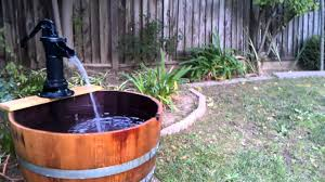 creative diy water fountain using barrel for cheap backyard garden