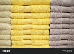 Selling Home Decor Yellow Towels Stack Shower Towels In Yellow And Brown Terrycloth
