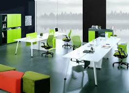 Green Office Chairs And White Office Staff Desks In Modern Office - Contemporary office furniture