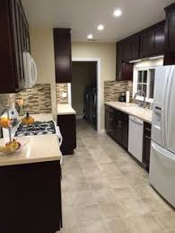 kitchen design with white appliances need opinions i love a black cabinet orangish walls kitchen design