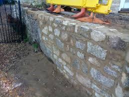 random stone garden wall repair in syresham northamptonshire