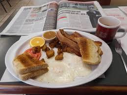 cuisine de cing file deux oeufs tournes bacon et journal 33 jpg wikimedia commons