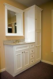 floor to ceiling bathroom storage cabinets about ceiling tile