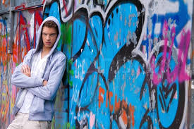 Cool Looking - a cool looking in front of graffiti stock photo