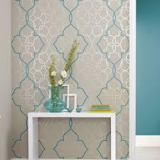 tapisserie salle a manger papier peint à entrelacs bleu canard sur fond de gris mastic et