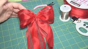how to make an easy bow for a gift or christmas tree step by