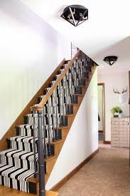 our black painted staircase bright green door